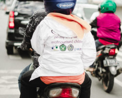 An OTIFA volunteer 'on her way to save a child', using a 'KlikQuick' motorcycle service
