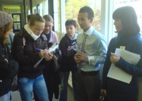 Pupils from Tooropmavo school in Rotterdam exchange contact details with their fellow student from Baolin, Yan Qian, during his visit to The Netherlands